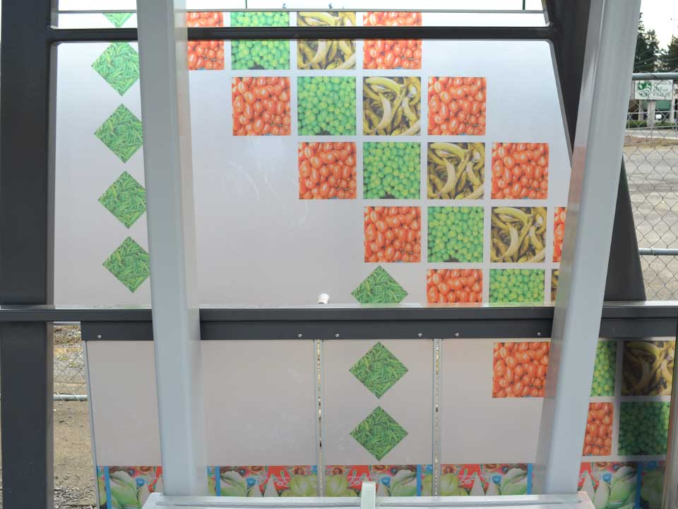 This design celebrates the food of Fourth Plain's international corridor with a quilt-like design made of photographs of produce in stores. The quilt design serves as a metaphor for the patchwork of different cultures in the area.