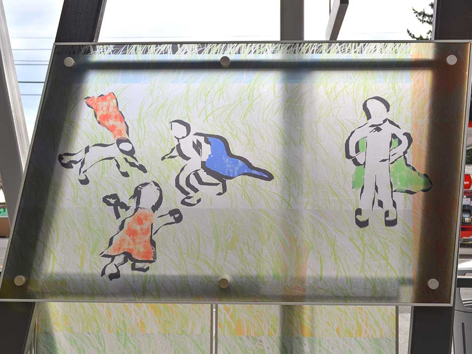 Located next to Evergreen Park, this station design includes whimsical images of children playing in a grassy pattern. During the summer, the park is often busy and hosts numerous youth-friendly events.